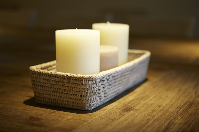 Three candles in a wicker candle holder