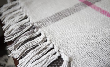 White blanket with grey stripes