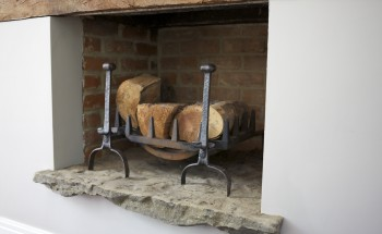 Stone fireplace with wood